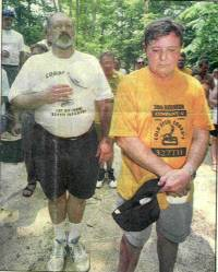 Lewis Percy of Auburn, N.Y. and Richard Kirk of San Antonio, Texas pay tribute to fallen comrades.