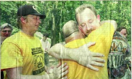 Charles Davidson, right, whose father was killed in Vietnam, is comforted by Terry Whitpan of Wyoming, left and Bill Fowler of Georgia