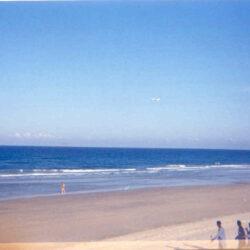 "South China Sea Beach - 6th CC Cam Rahn Bay. There goes a ""Freedom Bird""."